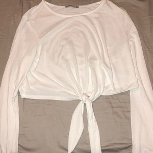 long sleeve cropped top with a tie at the bottom